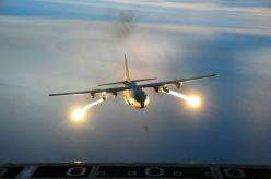 "Light It Up  Flares light up the sky from a C-130 Hercules, part of the 107th Airlift Wing. As the U.S. Air Force explains, ""A flare is an aerial infrared countermeasure to counter and infrared homing, heat seeking, surface-to air or air-to-air missil"
