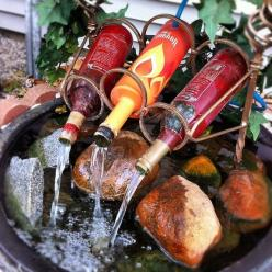 Love this fountain. What a great use for old wine bottles.: Ideas, Water Features, Outdoor, Waterfeature, Water Fountains, Wine Bottles, Wine Bottle Fountain