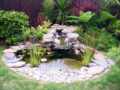 natural small garden ponds 12Natural pond is one of great small garden ponds ideas. You can make it by using PVC lining and place it with some rocks around it and decorate with water plants. In order to beautify it, you can raise some fish in it, such as