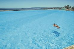 No jellyfish,sharks,or seaweed!! World's largest swimming pool  - in Chile - 1013 meters long covers 80 acres, its deepest end reaches 115ft and it holds 66 million gallons of water..... I NEED TO BE HERE!: Dream Vacation, Bucket List, Swimming Pools,