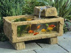 Now here's an interesting take on the backyard water feature.: Outdoor Aquarium, Garden Ideas, Fish Tanks, Water Features, Fishtanks, Gardens, Backyard, House