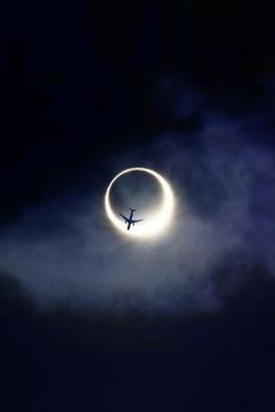Plane over an eclipse  (Source: obviously-addicted, via live-vibe) Posted: Fri July 20th, 2012 at 12:23am | Originally posted by opcion.: Picture, Thepinsource, Night Flight, Airplane, Cloud, Jet, Photo, Moonlight, Eclipse