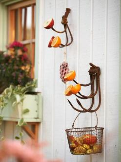 Provide for Nature: Cast-off cultivator tines are perfect perches for a host of summer bird treats. Oranges, apples, and a mesh bag filled with sour cherries beckon birds. When the season for fresh fruit passes, dangle suet cakes and protein-packed peanut