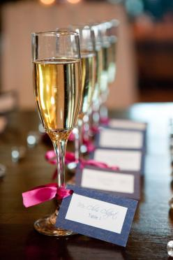 seating ideas The champaign is the touch of gold and the card is royal... Would look pretty and simple for the two of you and the wedding party...mothers and that. And we could easily etch their initial as a gift...: Champagne Glasses, Escort Cards, Weddi