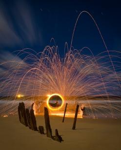 sparks + long exposure - did not read it yet, but I imagine it is done with steel wool that has been lit & swung in a circle: Long Exposure Light, Light Photography Painting, Firework Photogrpahy, Long Exposure Photography, Long Exposure Photos, Photo