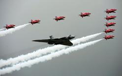 The Red Arrows fly in formation alongside an Avro Vulcan bomber  to officially open the Farnborough International Airshow in Hampshire...: International Airshow, Raf Red, Arrows Fly, Avro Vulcan, Aircraft, Vulcan Bomber, Red Arrows Vulcan