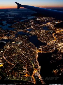 This is Stockholm, and it's sadly not my picture, but it reminds me of so many night landings in Chicago from my childhood. City lights from the window seat of an airplane...nothing like it in the world.: Cities, Stockholm, City Lights, Beautiful Plac