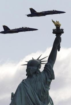 Two US Navy Blue Angels jets are seen from Liberty State Park as they flew over the Statue of Liberty. The two F/A-18 Hornet Fighter Jets were on a practice run for a potential flight course for this year's Fleet Week celebration in May.: Statue Of Li