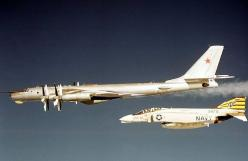 "US Navy McDonnell Douglas F-4 Phantom intercepting Soviet Tupolev Tu-95 ""Bear"" reconnaissance bomber near U.S. aircraft carrier, circa 1970s.: Russian Warplanes, Early 1970S, F 4 Phantom, Soviet Tu 95, Intercepting Russian, Cold War, Photo, Phanto"