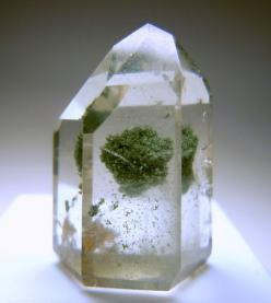 A colorless polished Quartz with a big green cluster of Chlorite inside: Big Green, Crystals Minerals Gemstones, Crystals Gemstones Etc, Crystals Gems Minerals Fossils, Quartz Crystal, Crystals Stones, Gems Stones, Crystal Grid, Amazing Crystals