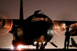 A Hercules C130 Transport Aircraft waits on the tarmac at a Middle Eastern airfield prior to taking off.: Hercules C130, Fighter Planes Jets, Aviation, C 130 Hercules, C130 Hercules, Aircraft, Planes Trains, Mod Photos