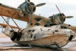 Abandoned Sea Plane. The aircraft is a Catalina PBY-5A model and was bought from the US Navy by Thomas W Kendall, a retired businessman who converted it to a luxury flying yacht.: Airplane, Aircraft, Planes, Saudi Arabia