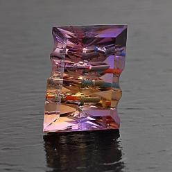 "Ametrine ""GEM-INTRUSION"" technique consists of precisely inserting solid colored gemstones into a faceted and carved transparent host gem. The result is a play of colors like a visual kaleidoscope, a gem with internal ""fireworks"".: Internal Fi"