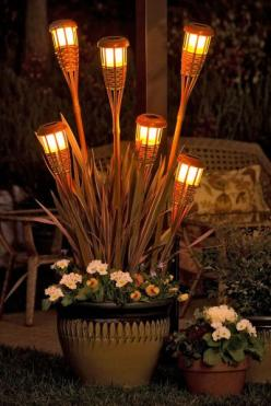 Brighten up your outdoor entertaining space with a planter filled with bamboo solar lights.: Solar Tiki, Lighting Idea, Garden Outdoor, Solar Lights, Patio, Backyard, Gardening Outdoor, Tiki Torches, Yard Ideas