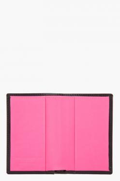 "COMME DES GARÇONS WALLETS //  Black and pink patent Card Holder  31230M005001  Patent leather card holder in black. Document pocket and two card slots at interior. Fully lined in neon pink leather. Tonal stitching. Approx. 4"" length, .5"" width, 2."