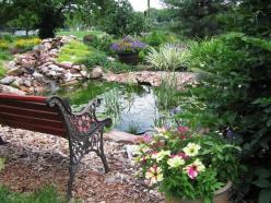 Don't have a view? Create one! This garden bench affords a peaceful place to relax amid perennials, roses and container gardens. Posted by gardenqueen5 - Our Favorite Garden Ponds From Rate My Space on HGTV: Water Feature, Ponds, Benches, Outdoor, Gar