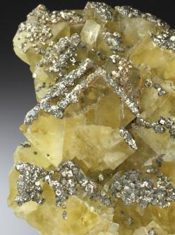 Fluorite with Pyrite. An excellent cabinet specimen of Fluorite from one of Cornwall's most well known Lead mines. The Fluorite forms lustrous bright yellow transparent to translucent cubic crystals to 3.5cm on edge. The Fluorite displays an intense p