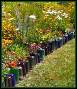 Glass Bottles border flower bed. Sometimes I think this looks trashy, but here it looks nice. Maybe in a circle around a plant ?: Ideas, Outdoor, Gardens, Glass Bottles, Wine Bottles, Winebottle