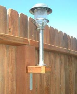 "Great idea for a large back yard: Use your solar lights. They aren't just for the ground!  Take a 2x4 and cut them into squares to fit the existing fence posts. Using galvanized screws - not nails - to screw a ""L"" bracket to the underneath bas"