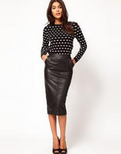 Leather pencil skirt.  Pencil Skirt: A pencil skirt is a slim-fitting skirt with a straight, narrow cut. Generally the hem falls to, or just below, the knee and is tailored for a close fit. It is named for its shape: long and slim like a pencil.  Leather:
