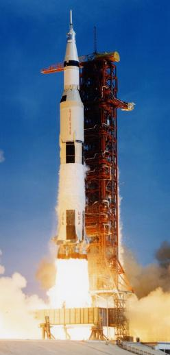 """Lift-off of the Saturn V rocket, carrying astronauts Neil Armstrong, Michael Collins, and Edwin """"Buzz"""" Aldrin Jr, along with 6,700,000 pounds (3,039,000 kg) of fuel and equipment into the Florida sky, bound for the Moon, on July 16th, 1969. (NASA)"""