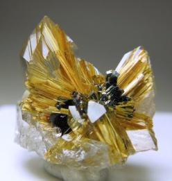mineralists:  Two colorless Quartz crystals with golden Rutile needles on and inside them. there are also plates of Hematite in the center. The Rutile radiates from the Hematite center. Novo Horizonte, Brazil: Crystals Stones, Rocks Minerals, Rocks Crysta