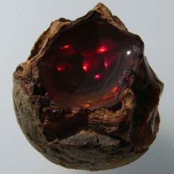 "Someone broke open one of those stones from ""Temple of Doom""   (Opal / Ethiopia): Deep Red, Minerals Gemstones Crystals, Red Opal, Gemstones Opal, Rocks, Opals, Ethiopia Mineral"