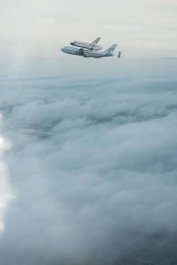 spaceplasma:    Above the Clouds  Space Shuttle Endeavour being ferried by NASA's Shuttle Carrier Aircraft as it departs KSC. NASA pilots Jeff Moultrie and Bill Rieke are at the controls of the Shuttle Carrier Aircraft. Photo taken by NASA photographer Ro