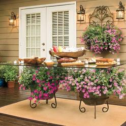 Spectacular Container Gardens: Trailing Petunias - Spectacular Container Gardening Ideas - Southern Living: Container Garden, Garden Ideas, Outdoor Table, Outdoor Living, Gardens, Gardening, Patio Table, Flower, Glass Tables