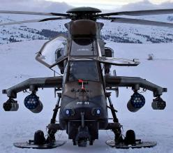 The Eurocopter Tiger is a four-bladed, twin-engined attack helicopter which first entered service in 2003. It is manufactured by Eurocopter, the successor company to Aérospatiale's and Daimler-Benz Aerospace AG's respective helicopter divisions, w