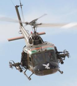 The helicopter represents the part of the play where the grooms are shooting down at the brides killing them.: Aviation, Military Aircraft, Vietnam War, Huey Helicopters, Cobra Helicopters, Helicopters Wars