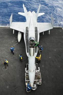 U.S. Navy sailors prepare to maneuver an F A-18C Hornet aircraft assigned to Strike Fighter Squadron 97 on the aircraft carrier USS John C: Carrier Uss, Aviation, A 18C Hornet, Navy Sailor, Aircraftcarriers, Jet Fighter, Planes, Fighter Jets, Aircraft Car