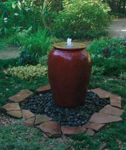 Video: How to Build a Pot Fountain. Surely there's some way to avoid filling the entire vessel with water. Perhaps a plate at the top that simply makes a shallow dish of water, spills over onto the stones, and is pumped back up. Would make it more bir