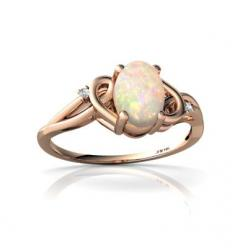 Elegant, simple and classic, this ring is perfect for everyday wear with a beautiful, curvy setting, an oval shaped gemstone of your choice, and two dazzling diamonds.  $179: Simple Opal Ring, Gemstone, Opal Rings, Fire Opals, 7X5Mm Oval, Gold Fire, Diamo