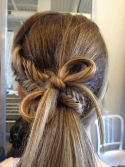 fishtail starting from one side down along the back of your head, and then wrap it underneath the remaining hairs. maybe she used the bottom part of her braid inorder to create the bow? :) you can tie a bow as you do with string but be sure to use pins to