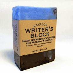"From the maker: ""Try this specially-crafted Writer's Block soap. If this soap doesn't help you churn out regurgitated ideas and probably a vampire, I'll eat my hat. It's a fedora, by the way. Cool vampires wear fedoras now. Put that in your crack pipe"
