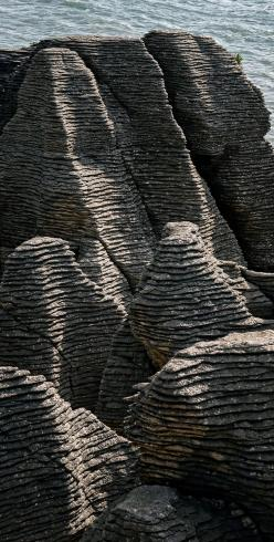 Punakaiki is on the road between Westport and Greymouth and is a geological feature of stratified rock formations. The feature is known as the Pancake Rocks - NZ: Formations Pancake, Rocks Punakaiki, Rock Formations, Cliff, Newzealand, Stratified Rock, Ne