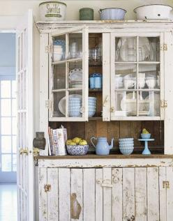 Rustic Cupboards In a New York farmhouse, a vintage-style kitchen cabinet was created in Vermont from reclaimed barn wood. It showcases a collection of blue and white dishware.  Read more: Farmhouse Style - Rustic Home Decor - Country Living: Cabinets, Ki