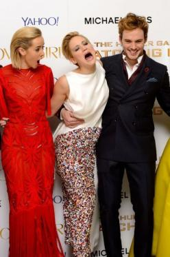 Funny Red Carpet Pics - Celebrity Wardrobe Malfunctions. Look at Finnick's face... Lol: Catching Fire, Hunger Games, Funny, Hungergames, Sam Claflin, Games Cast, Jennifer Lawrence, Jlaw, Jenniferlawrence