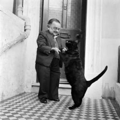 I adore this photo. The entryway looks like it's in England. The milk bottles don't help much except to say that the photo is sometime between 1940-1980 which is SO not helpful!: Cats, Dancing, Henry Behrens, Photo, Dance, Black Cat, Animal