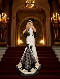 If I were EVER to get married... I would hands down want my wedding dress to be something like this... No doubt in my mind.  I wouldn't ever do the black wedding dress, but I would totally do something like this.: