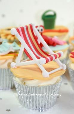 Silver wrapper for simple vanilla cupcake makes it more interesting. The tiny chair decoration is just fantastic.: Cupcake Company, Cup Cake, Vanilla Cupcake, Deckchair Cupcake