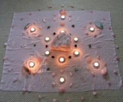 So what in the world is a crystal grid? When you are healing with crystals, you can arrange several crystals in a geometric pattern to direct energy and make your healing work more powerful. I have come across some amazing pictures of these crystal grids.