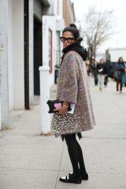 """A cold-weather outfit full of texture and whimsy, from the voluminous sequined coat layered over a hooded jacket to a clutch emblazoned with a giant heart. I also love her two-tone loafers.   """"On the Street…..21st Street, New York"""", Photography by"""