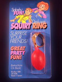 SQUIRT RING...... Surprise your friends when you show them the new ring you bought. When they get close to look, squeeze your hand and they'll get squirted in the face. Great prank! www.theonestopfunshop.com