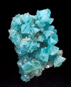 Boracite- a magnesium borate mineral with formula: Mg3B7O13Cl. It occurs as blue green, colorless, gray, yellow to white crystals in the orthorhombic - pyramidal crystal system. Boracite also shows pseudo-isometric cubical and octahedral forms. These are