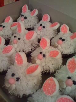 Bunny Cupcakes - cut large marshmallow in sections for the ears, sprinkle sticky part with colored sugar.  I would suggest stopping there!  Just use smooth icing on top.  Simplicity.  Who really wants to think about biting into an actual rabbit?: Cup Cake