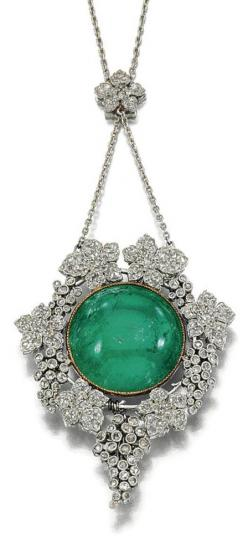 EMERALD AND DIAMOND PENDANT. The pendant designed as a central cabochon emerald within a surround of fruiting vines decorated to the front and back with millegrain-set circular- and rose-cut diamonds to a floral connecting link set with rose-cut stones, l