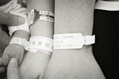 Photo of baby, mama and daddy hands and hospital bracelets