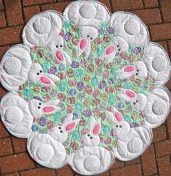 """~40"""" diameter. Ten sweet bunnies show off their tails which use chenille fabric 'you' make. Stacked appliqué is completed while quilting to make this a quick: Ideas, Sweet Bunnies, Pattern, Quilted Garden, Quilts, Quilting, Products, Ten Sweet"""